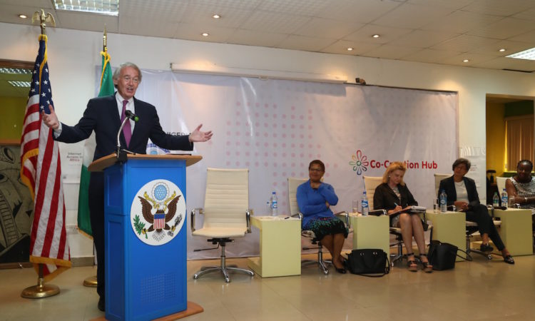"US Senator Edward J. Markey (D-Mass), giving remarks at the Co-Creation Hub, Lagos. On stage: L-R: US Representative Karen Bass (D-Calif), US Representative Carolyn Maloney (D-NY), USAID Ann Mei Chang, and CEO Main One Cable Company Funke Opeke."" alt=""US Senator Edward J. Markey (D-Mass), giving remarks at the Co-Creation Hub, Lagos. On stage: L-R: US Representative Karen Bass (D-Calif), US Representative Carolyn Maloney (D-NY), USAID Ann Mei Chang, and CEO Main One Cable Company Funke Opeke."