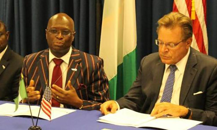Joseph Adebiyi, Director, CESEL (left); Dr. Patrick Tolani of CESEL (center); John Bray, U.S. Consul General of Lagos (right)