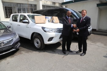 Consul General F. John Bray (right) with Director of Training and Manpower Development, Nigeria Drug Law Enforcement Agency (NDLEA), Dr. Linus Opara, during the donation of vehicles and technical equipment to the NDLEA by the United States government in Lagos on Wednesday. Photo: U.S. Consulate General Lagos.